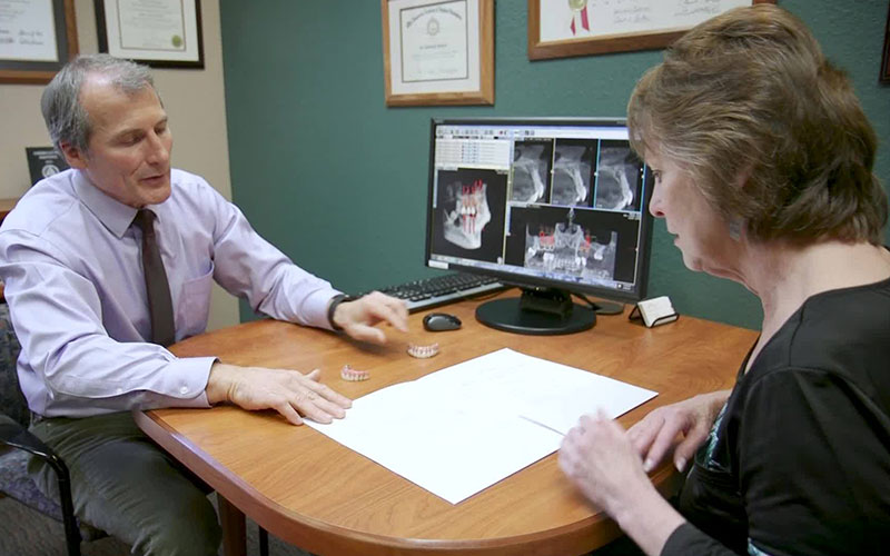 Dr. Howard talking to a female patient